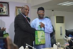 Acting Chairman ICPC, Dr. Musa Usman Abubakar receiving some publications of INEC from its Chairman, Prof. Mahmoud Yakubu