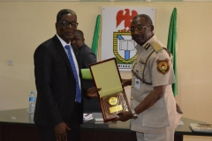 Mr. Samuel Vongtau [L], who represented the Executive Secretary NSC, receiving a commemorative plaque from NIS Controller-General, Muhammed Babandede [R] during the courtesy visit