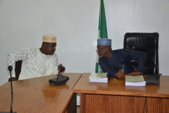 Alh. Bako Abdullahi, the out-gone Acting Chairman in a discussion with Secretary to the Commission, Dr Musa Usman Abubakar