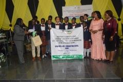 Mrs. Azuka Ogugua of ICPC, presenting IEC materials to students of Titsall Global Schools, Wuse II, Abuja