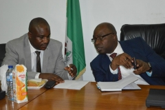 ICPC Chairman, Prof. Bolaji Owasanoye [R] discussing with Secretary to the Commission, Dr. Musa Usman Abubakar [L]