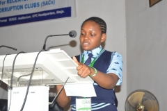 Overall winner of the Essay Competition, Mbong Utibe-Abasi of Imperial Secondary School, Eket, reading the winning essay at the ceremony.