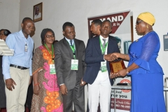 Second runner-up, Abuka Victor Okezie of King's College, Lagos, receiving his award from Director, Public Enlightenment, Mrs. Rasheedat Okoduwa, who represented the ICPC Acting Chairman, Dr. Musa Usman Abubakar, at the ceremony.