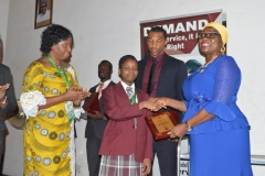 First runner-up, Orogbu Nnedinma of New Foundation Secondary School, Lagos, receiving his award from Director, Public Enlightenment, Mrs. Rasheedat Okoduwa, who represented the ICPC Acting Chairman, Dr. Musa Usman Abubakar, at the ceremony.