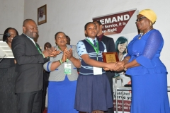 Overall winner, Mbong Utibe-Abasi of Imperial Secondary School, Eket, receiving her award from Director, Public Enlightenment, Mrs. Rasheedat Okoduwa, who represented the ICPC Acting Chairman, Dr. Musa Usman Abubakar, at the ceremony.